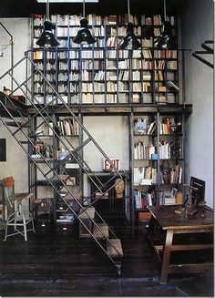 I've ALWAYS wanted a 2 story library with a rolling staircase. This version is that, but with an industrial take. That's a win