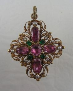 Antique pink topaz, emeralds,and pearls pendant in 15 carat gold setting. English ca 1820