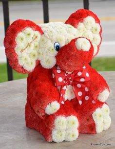 This FlowerToy® red elephants is made from fresh flowers. Order online @