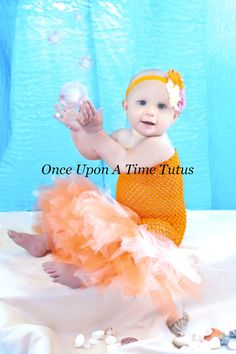 Check out this item in my Etsy shop https://www.etsy.com/listing/193913476/orange-mermaid-fishtail-tutu-set-baby