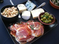 Spanish Tapas - Serrano Ham, Marcona Almonds, Marinated Sevilla Olives, and Assorted Spanish Cheeses (Manchego)