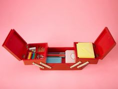 """""""I use an old sewing box for desk supplies like paper clips, pens, stamps and stationery. The expandable trays fold up neatly when I'm done working."""" — Elizabeth Geddes, owner of Octavia & Brown vintage shop, New York City etsy.com for a similar look"""
