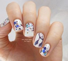 Create pretty looking watercolor splashes on your nails with this watercolor nail art references. Work with a white base color and start adding polishes in different colors. You can also add intricate details on the nails to make a good accent.