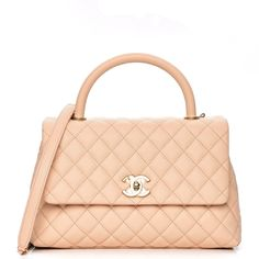 6e483d9ebabddb This is an authentic CHANEL Caviar Quilted Small Coco Handle Flap in Light  Beige. This