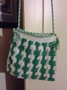 Own design. Green/Cream 100% cotton. Beautiful hand crafted crocheted shoulder bag. Hand made Kumihimo braided top with incorporated strap
