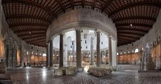 Santo Stefano Rotondo al Ceilo, Rome.  When you enter, you see a ring of Ionic columns supporting the drum and surrounding the main altar in the center.  Around this ring is an ambulatory which runs round the entire interior.