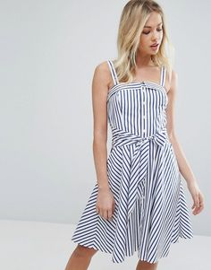 Cotton, Semi-circle skirt, faux tie coming in at waist seem and only on front, button down tank top  ASOS-Discover Fashion Online