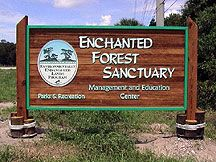 Entrance sign to Enchanted Forest Sanctuary - Titusville Florida.  Located on the north side of State Route 405, 1/2 mile west of U.S. Route 1, in south Titusville. Several miles of hiking trails allow visitors to enjoy the natural beauty of this area of Florida.  Wildlife species found here include the Eastern Indigo snake, Florida scrub lizard, gopher tortoise, white-tailed deer, and bobcat.