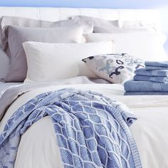 Add some summer freshness into a room with crisp whites and pops of periwinkle blue.