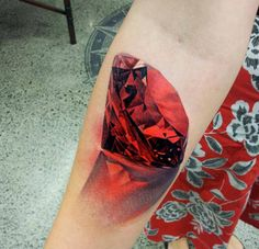 Hand Huge Ruby realistic tattoo