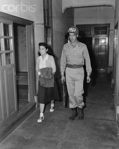 "Tokyo Rose Led To Yokahama Prison Cell - BE035033 - Rights Managed - Stock Photo - Corbis. Original caption:10/25/1945-Yokahama, Japan: Iva Toguri, Better known as ""Tokyo Rose"", led to her cell in Yokahama Jail by T/5 William Evens."