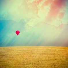 red balloon over fields