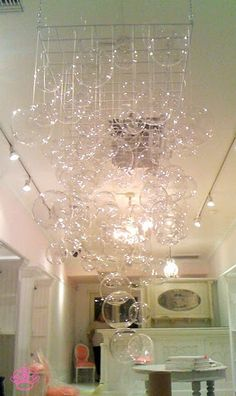 Bubble chandelier made from clear christmas ornaments on string bubble chandelier diy faire frou frou in los angeles aloadofball Gallery
