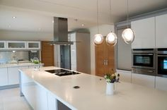 long kitchen island with hob and sink