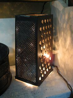 Must now hunt down old cheese graters and use them around pillar candles as outdoor table lanterns!!!