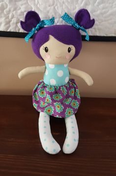 Cloth Baby Doll, Rag Doll- Handmade Doll-Fabric Doll-Girl Soft 18 inch Doll with Purple fleece hair and pigtails.  Your child will love snuggling up with this cute doll with removable skirt.  This doll is safe for all ages. Made from cotton fabric and fleece hair.  Made in a pet free smoke free home.  Made and ready to ship.