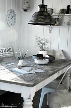 rustic white on white kitchen with metal chair and light fixture...lovely composition.
