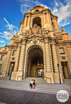 Beautiful architecture and grand landscape and history - a Pasadena City Hall Engagement - formal with a stylish Bebe black gown and Calvin Klein black suit