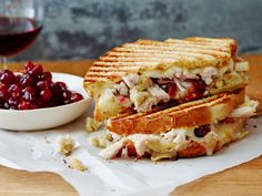 Leftover Thanksgiving Panini : Ree piles leftover turkey on top of fresh sourdough, along with leftover cranberry sauce, gravy and Swiss cheese, to make a crusty grilled panini.