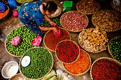 A woman sells various chilis and spices at her street side market in Hanoi's Old Quarter.