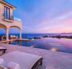 Luxury pool and space overlooking a gorgeous coastal sunset.