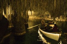Classical musicians performing in rowboat in Cuevas del Drach Cave (Cavern of the Dragon).