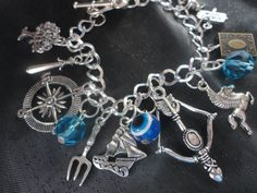 Percy Jackson charm bracelet IM GETTING ANNOYED? WHERE DO YOU FIND ALL THIS!!! I WANT SOME!!!