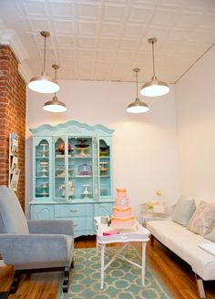 consultaion area, love the turquoise cabinet