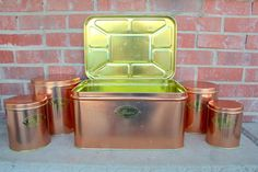 Vintage retro copper colored tin kitchen canister and bread box collection. 5 piece set.