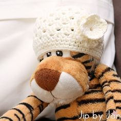 How a tiger doesn't get any happier when he gets a hat that fits. Weird...