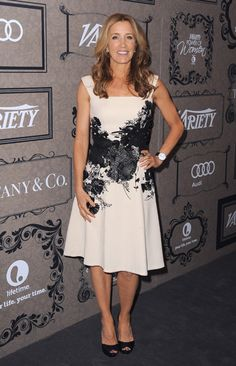 Felicity Huffman cute dress: fit-n-flare with designs/applique
