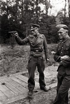 History Discover German officer firing a Luger Pistol.