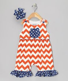 Designed with jazzy zigzags, button-up straps and handy snaps at the thigh, this capri-length one-piece radiates with sweetness and goes on easy. A cushy, coordinating bow finishes the look.Includes romper and clip100% cottonMachine wash; hang dryImported