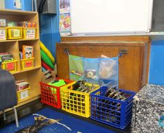 Crates with clipboards/white boards/etc near the carpet for group activities