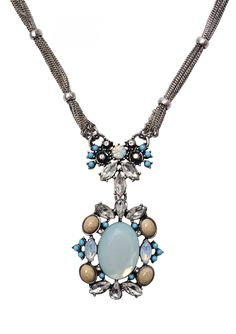 Long multi chain statement necklace with an intricate design of blue and crystal gems in the center and an even larger oval one at the very bottom, also with blue and crystal gems. Style this with anything casual or dressy in blue, navy, or white.
