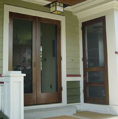 Double Manhattan screen & storm door. Shown in Solid Poplar with exterior stain/urethane by others. Browse more Traditional door deisgns which can be made into double doors like this one.