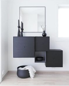 Frame is a flexible storage solution signed @bylassen comprised of square boxes in cubic frames. Frame modules can be hung directly on the wall or stand on their own on the floor.  This is a beautiful shot by ingvild90 : the black setting was styled with four Frame storage boxes and a black View Mirror mounted on the wall.  Get inspired on #archiproducts!