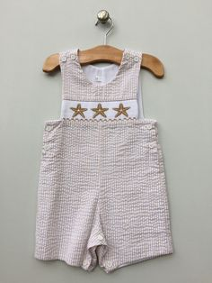 Baby Boys Smocked Beige & White Seersucker Starfish Romper MBL 41 by Lambs in Ivy Traditions Price: $33.99 Options: 2T, 18M, 12M, 9M, 6M  To purchase comment Sold, Size, and Email Address!  Then connect here: https://www.soldsie.com/pin/661377 www.lambsinivy.com