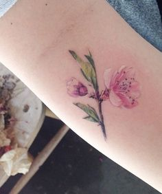 Small flower tattoo More