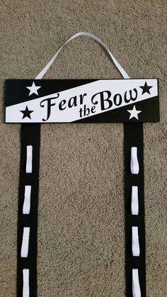 Hey, I found this really awesome Etsy listing at https://www.etsy.com/listing/224338943/fear-the-bow-custom-cheer-bow-holder
