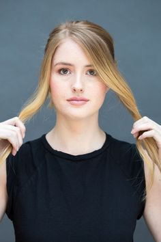 """Separate two face-framing pieces and pull the rest of your hair into a pony. """"You only need to have about a half inch of hair to create the 'headband' but if you hair is very thick, then you'll need to section off about an inch instead,"""" says Peña, who recommends TRESemmé Smooth Anti-Frizz Secret Creme to tame flyways."""