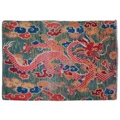 Tibetan Sitting Rug With Green Background Dragon Design | From a unique collection of antique and modern chinese and east asian rugs at http://www.1stdibs.com/furniture/rugs-carpets/chinese-rugs/