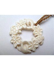 Carved Honu & Dolphin Round Hawaiian Necklace Pendant.   This uniquely designed hand carved pendant has been cut from cow bone and polished.   Displaying the Honu turtle, dolphins and Hawaiian plumeria flowers within this deco...
