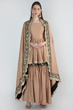 RANIAN Featuring a blush pink kurta in blended silk and modal silk base with gold round motifs. It is paired with matching sharara pants and dupatta having zardosi embroidery.
