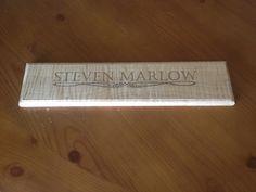 Laser engraved office door nameplate.