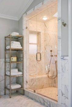 beautiful marble bathroom - love the shelf for towels. We could use one of those in our bathroom.