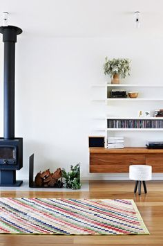 contemporary wood burning stove and shelving