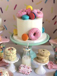 "Donut themed cake from a ""Donut"" Grow Up 1st Birthday Party on Kara's Party Ideas   KarasPartyIdeas.com (7)"