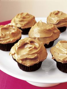 Chocolate Peanut Butter Cupcakes by The Barefoot Contessa - always a HUGE hit when I make them.  I just use a box mix for the cake part, the only thing we really care about here is the yummy peanut butter frosting.... soooooo goooood.  And we always make more icing than what the recipe calls for.