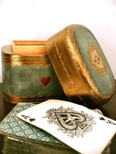 An antique box and a tatty old deck of cards..